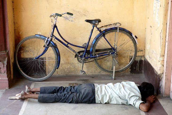 Bicyclist resting, Jaipur, 2005.