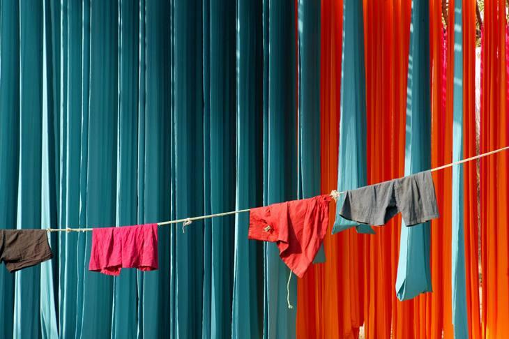 Freshly-dyed textiles drying, Sanganer, 2005.