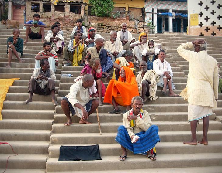 Men meeting on steps, Varanasi, India, 2005.