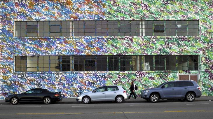 Building decorated by graffiti artist Barry McGee, 16th Street, San Francisco, California. November 2011.