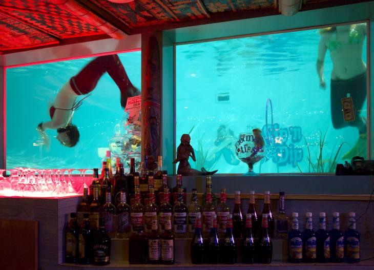 Live mermaids at the Sip 'n Dip Lounge, O'Haire Motor Inn, Great Falls, Montana. April 2011.