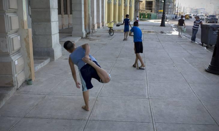Playing baseball along the Malecon, Centro, Havana.
