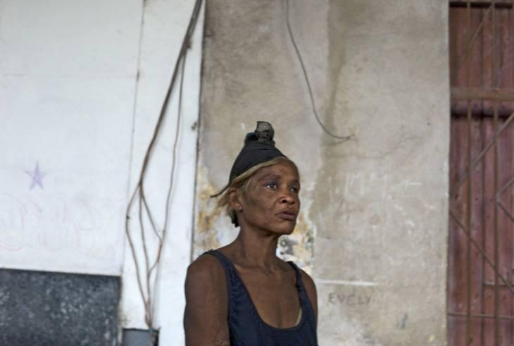 Woman watching a game of dominoes, Habana Vieja.