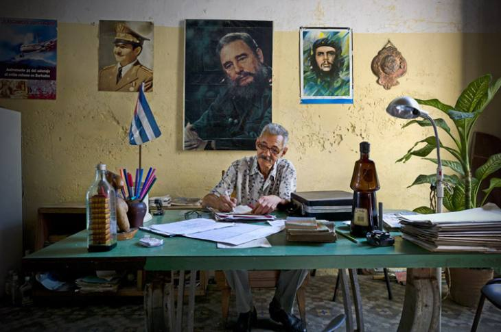 Man in office, Calle Cuba, Habana Vieja.