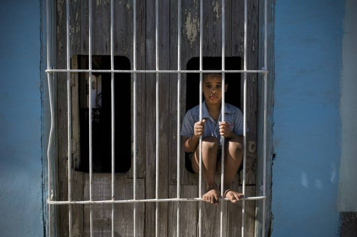 Boy in window, Trinidad.