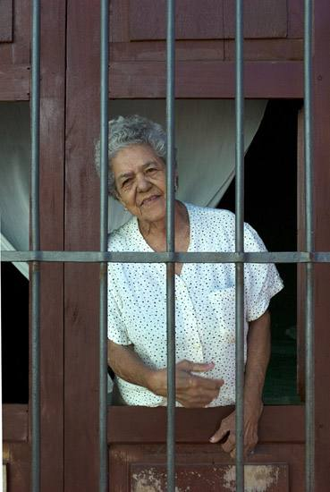 Woman in window, Trinidad.