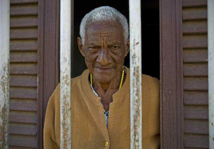 Woman in window, Trinidad.