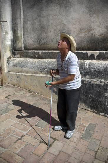 Blind beggar, Iglesia de la Santisima, Trinidad.